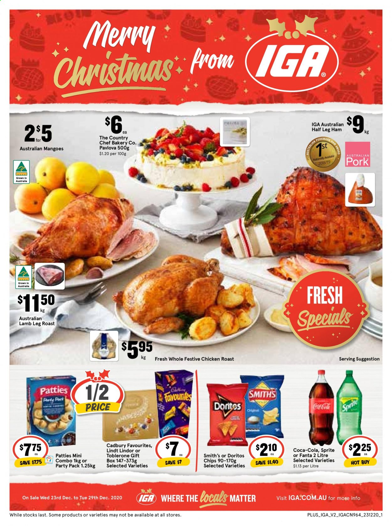 IGA Catalogue - 23.12.2020 - 29.12.2020 - Sales products - mango, chicken roast, leg ham, ham, Lindor, Lindt, Toblerone, Cadbury, Doritos, Smith's, chips, Sprite, Coca-Cola, Fanta, chicken, lamb leg, lamb meat, gift box. Page 1.