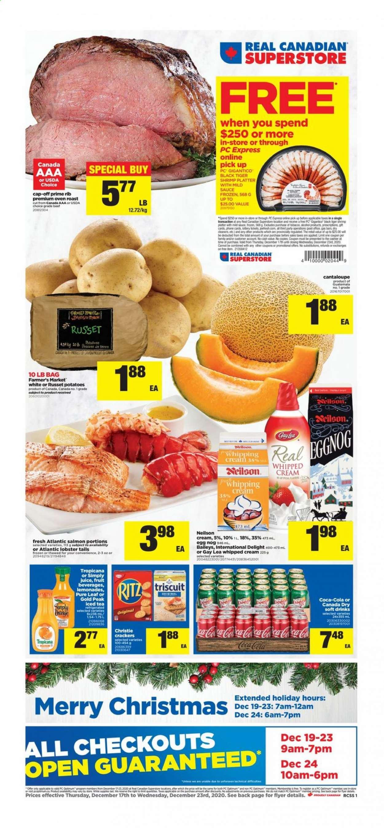 Real Canadian Superstore Flyer - December 17, 2020 - December 23, 2020 - Sales products - bag, beef meat, Canada Dry, cantaloupe, cap, coca-cola, eggnog, eggs, frozen, lobster, russet potatoes, salmon, tea, whipped cream, potatoes, oven, Baileys, juice, sauce, platter, shrimps, phone. Page 1.